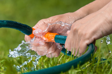 hands with hoses for irrigation