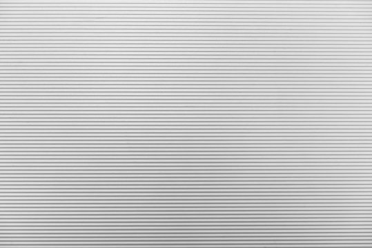 The line texture of the white shutter door of the factory building