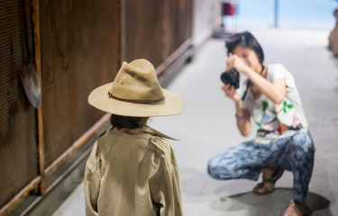 Mother is taking picture of an explorer girl
