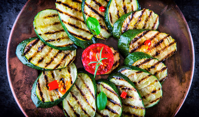 Grilled Zucchini Tomato with chili pepper.  Italian mediterranean or greek cuisine. Vegan vegetarian  food.