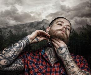 Shaving brutal tattooed male.