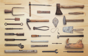 Old tools on wooden table. Traditional handmade tools for craftsmen.