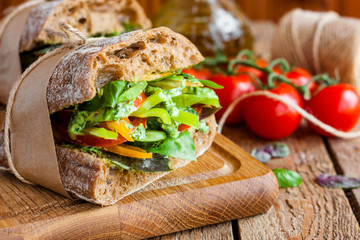 Photo on textile frame Snack veggie sandwich with vegetables and pesto