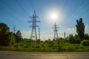 Electric Power Transmission Towers And Factory Smoke