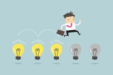 Businessman jump on light bulbs, vector