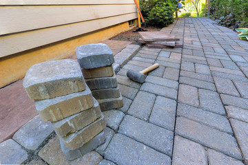Stone Pavers and Tools for Side Yard Hardscape