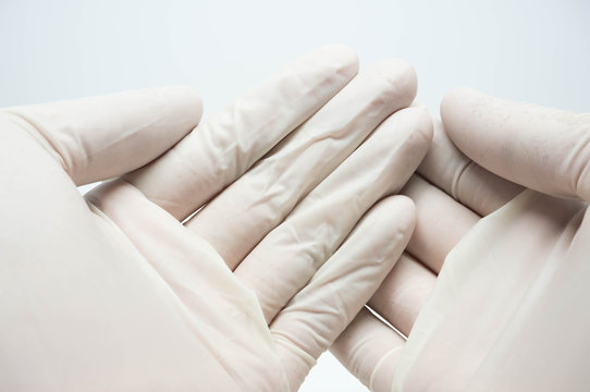 disposable sterile white gloves on white background