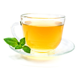 Transparent Cup of green chamomile tea with mint leaves On white background
