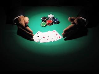 Man playing poker on green background.