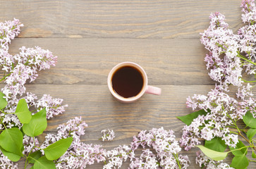 Cup of tea and lilac