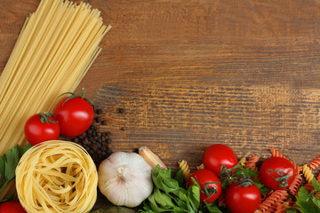 products for cooking pasta on wooden background