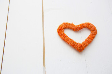 Romantic heart shape above wooden surface.