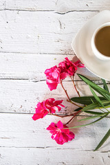 Cup of coffee with flowers