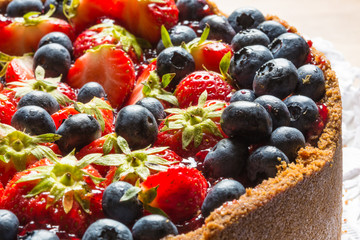 cheese cake with strawberries and blueberries