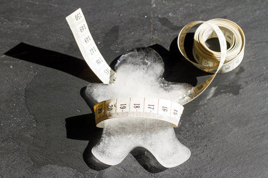 Lost weight and slim abstract concept with ice melting body and measure