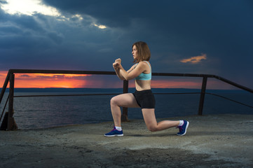 Fit woman in sportswear doing lunges