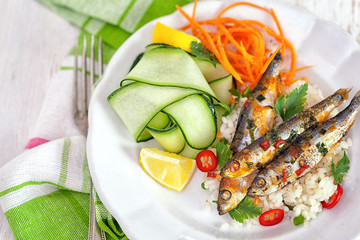 Grilled sardines with zucchini and lemon