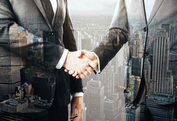 Businesspeople shaking hands multiexposure