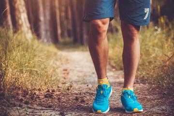 athlete running through the woods.