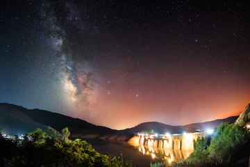Deurstickers Dam Dam at night under the milky way