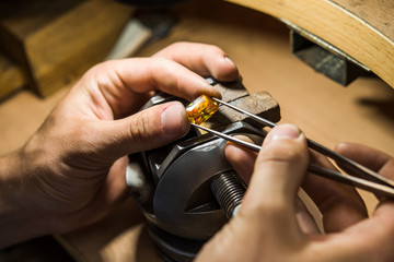 Craft jewelery making with professional tools. Ring repairing. P