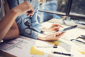 Successful Account Managers Team Analyze Business Reports Modern Interior Design Loft Office.Coworkers Using Contemporary Tablet.Sharing Information.Blurred Background.New Startup Idea Process.