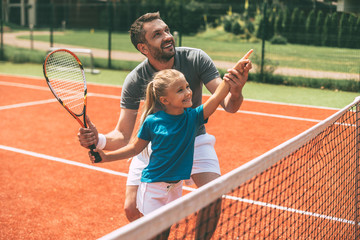 Tennis is fun when father is near.