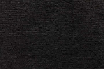 Black background from textile material. Fabric with natural texture. Backdrop.