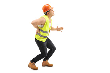 Male worker experiencing back pain