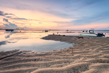 Holiday in Bali, Indonesia - Reflection Sunrise in Tanjong Benoa with boat