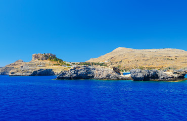 rocks in sea near ancient city of Lindos, view from the sea