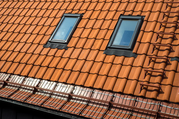 Tile roof and attic window.