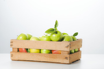Fresh apples in a wooden box.