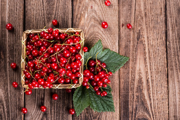 Fresh currants on wooden background