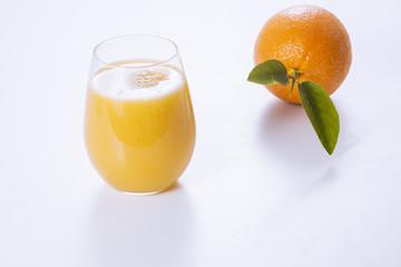 Fresh orange and glass of orange juice.