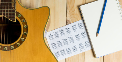 Guitar with Blank notebook for song writing.