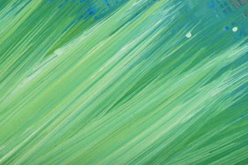 Green abstract hand-painted gouache brush stroke daub background texture.