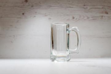 Empty Beer Mug on a light background