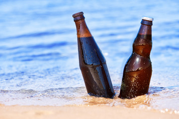 Beer in water at the coast
