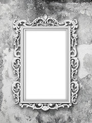 Close-up of one blank silver Baroque picture frame on gray weathered concrete wall background