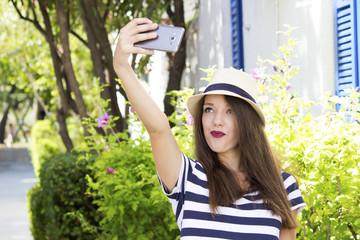girl smartphone selfie posing