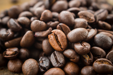 roasted coffee beans on the wooden floor as a background.