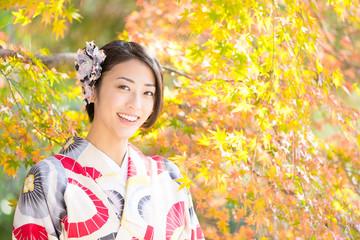 attractive asian woman wearing kimono in autumn