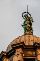 17th century bronze statue of the Virgin Mary on top of the dome of the Santa Maria della Salute church in the Dorsoduro quarter of Venice, Italy