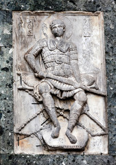 Medieval carving of a warrior saint on the San Marco Basilica facade in Venice, Italy