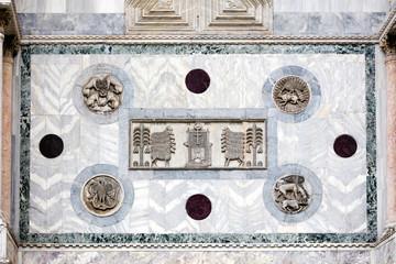 Medieval Venetian Gothic ornaments on the San Marco Basilica facade in Venice, Italy