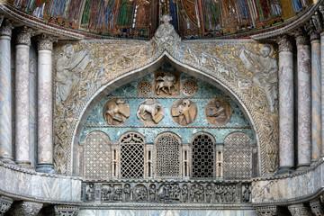 Details of the medieval Venice's San Marco Basilica facade above the San Alipio door.