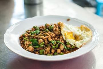 stir fried pork whit basil and fried egg Thai food