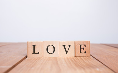The word LOVE over wood background