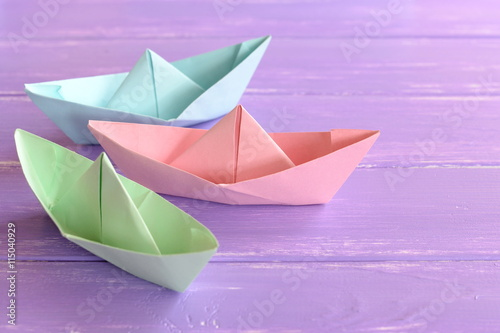 Pink Green Blue Paper Boats On Lilac Wooden Background Paper